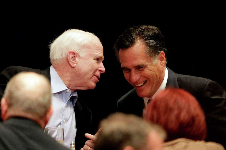 Republican presidential candidate, former Massachusetts Gov. Mitt Romney chats with Sen. John McCain, R-Ariz. at the RNC State Chairman's National Meeting in Scottsdale, Ariz., Friday, April 20, 2012. Photo: AP