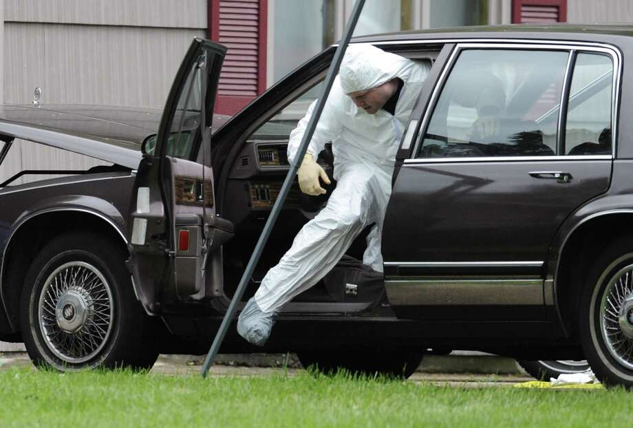 A law enforcement agent searches a vehicle at the home of reputed Connecticut mobster Robert Gentile in Manchester, Conn., Thursday, May 10, 2012.  Gentile's lawyer A. Ryan McGuigan says the FBI warrant allows the use of ground-penetrating radar and believes they are looking for paintings stolen from Boston's Isabella Stewart Gardener Museum worth half a billion dollars. (AP Photo/Jessica Hill) Photo: Jessica Hill, Associated Press / AP2012