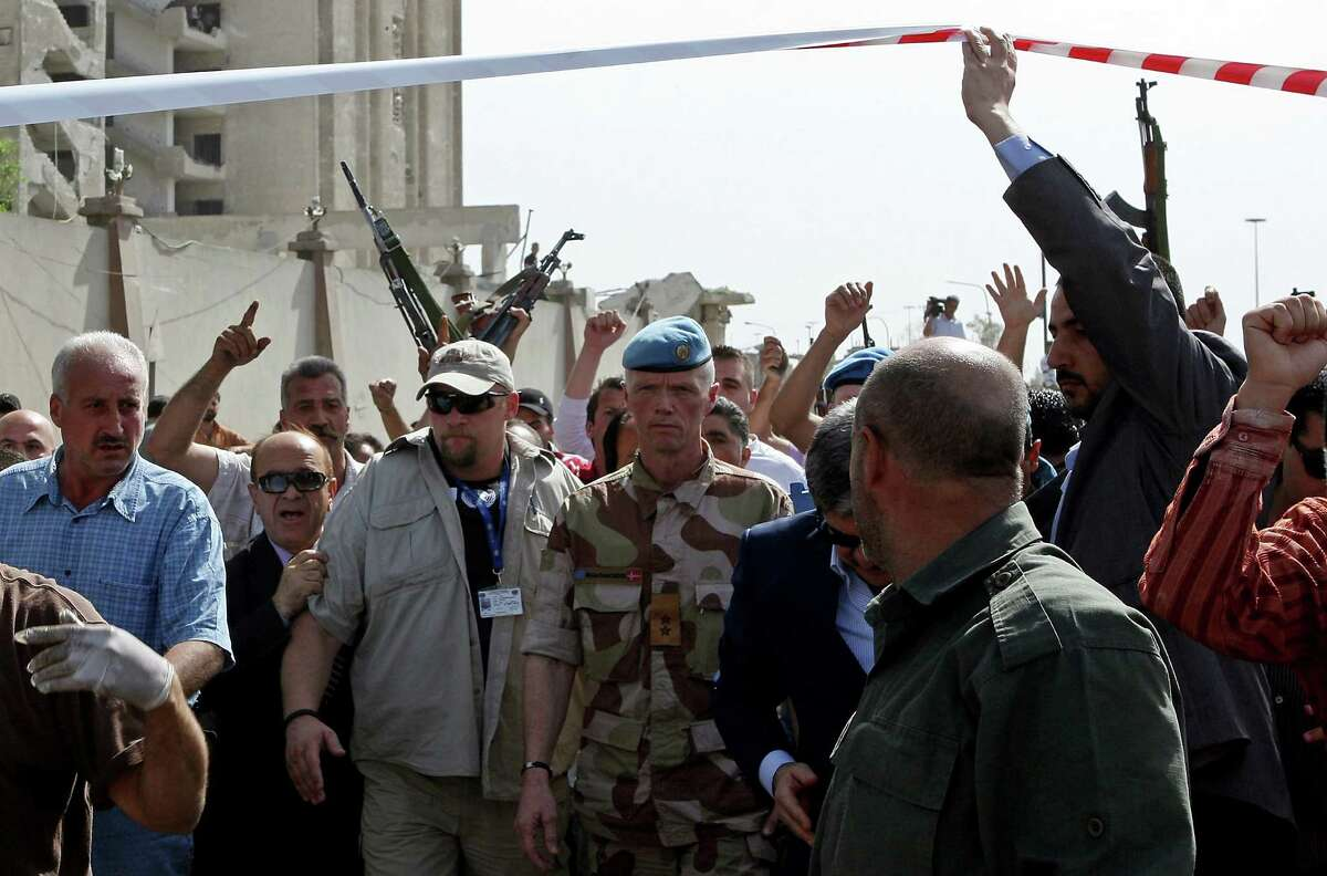 TOPSHOTS Norwegian Major General Robert Mood (C), the head of the UN observers mission in Syria, arrives to inspect the site of twin blasts in Damascus on May 10, 2012. Two powerful blasts in quick succession rocked the Syrian capital at morning rush hour, killing and wounding dozens of people, state television said, blaming the attacks on