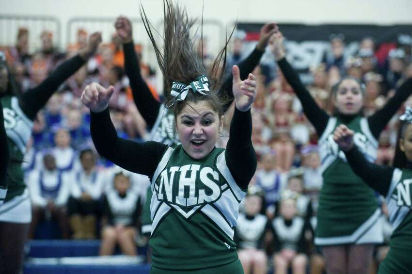 In thsi file photo Norwalk High School competes in the FCIAC Cheerleading Championships in Wilton, Conn., Sunday February 6, 2011.