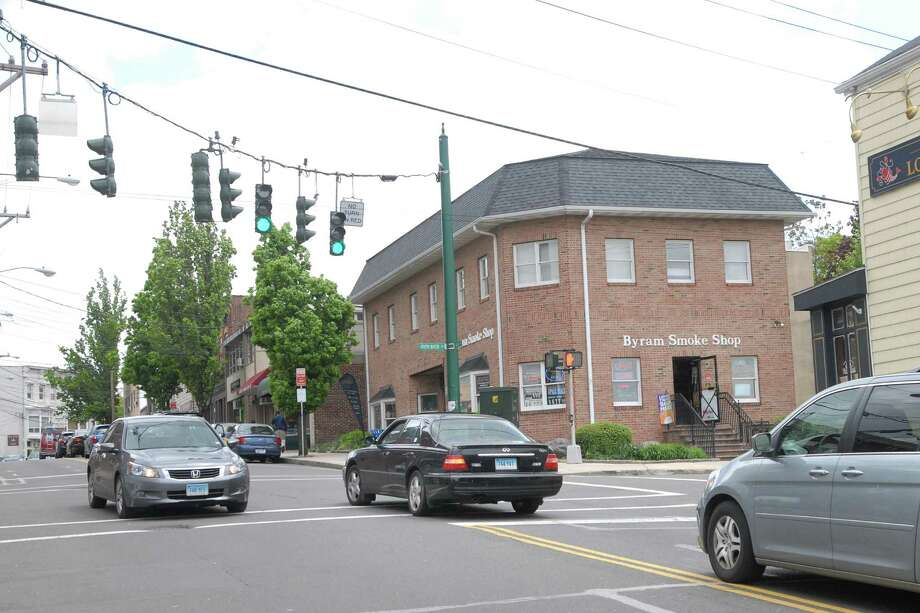 A vehicle, center, heading east on Mill Street in Byram, coming from Port Chester, N.Y., waits for passing traffic to make a left onto North Water Street, Thursday afternoon, May 10, 2012. The Board of Selectmen is considering traffic changes at the congested intersection that is a traffic hub between Greenwich and Port Chester, N.Y. Photo: Bob Luckey / Greenwich Time