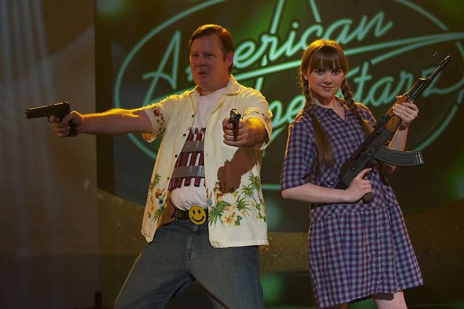 "Frank (Joel Murray) and Roxy (Tara Lynne Barr) shoot up America's favorite singing competition show in Bobcat Goldthwait's dark comedy, ""God Bless America."" Photo: Magnet Releasing"