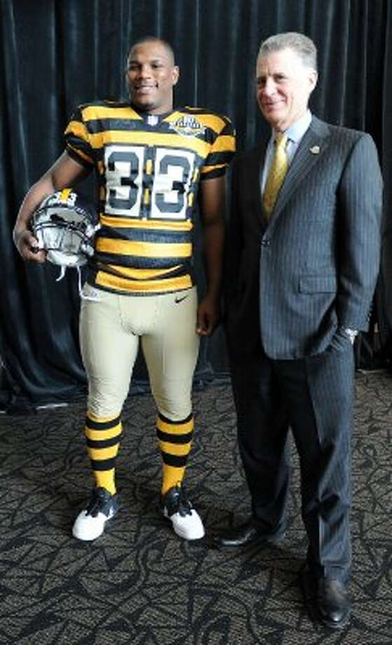 Pittsburgh Steelers running back Isaac Redman models the team's 2012 throwbacks ... to a bumble bee penitentiary? (Christopher Horner / Associated Press)