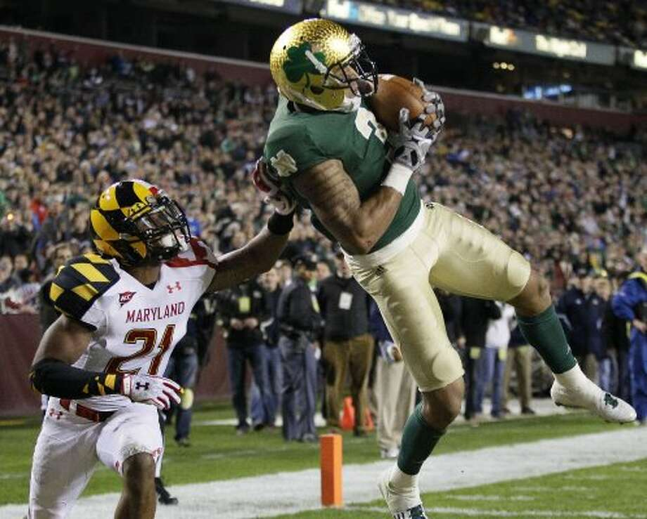 Notre Dame's 2011 alternate jerseys aren't ugly per se, but when you have one of the greatest, most iconic uniforms in sports, why dumb it down with kiddie shamrocks? (Patrick Semansky / Associated Press)