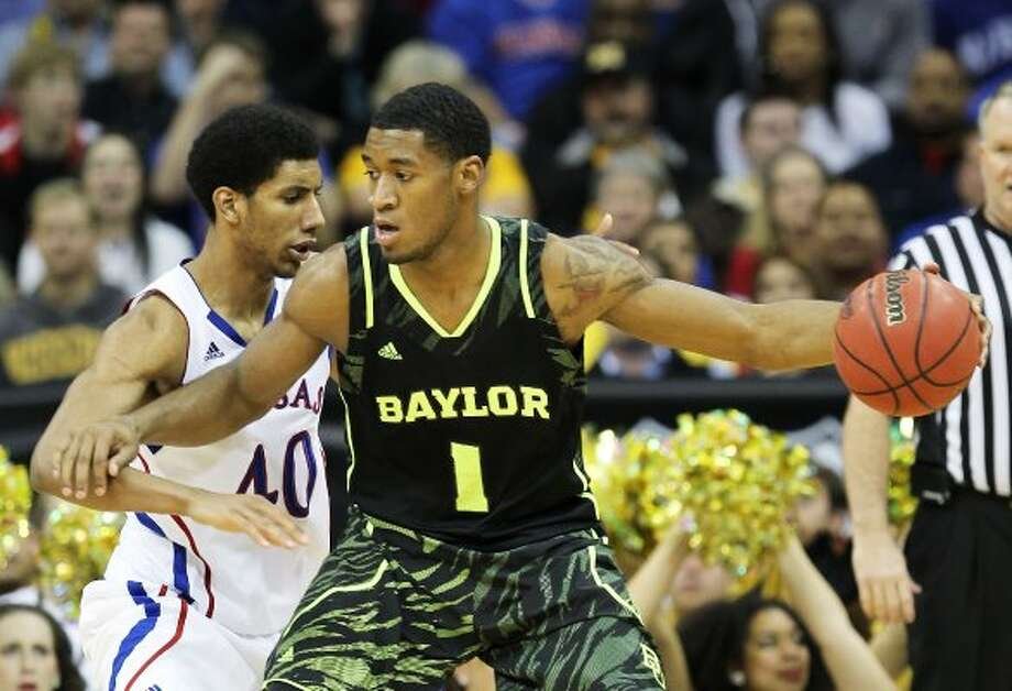 It's hard to decide which Baylor uniform from this year's NCAA Tournament is worse. The tiger-striped ones (their mascot is the bear, by the way)... (Jamie Squire / Getty Images)