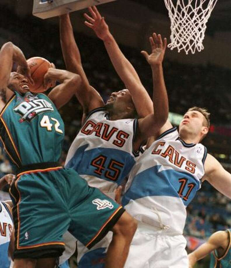 This photo has not one but two ugly uniforms. Teal doesn't really scream intimidating... (TONY DEJAK / Associated Press)
