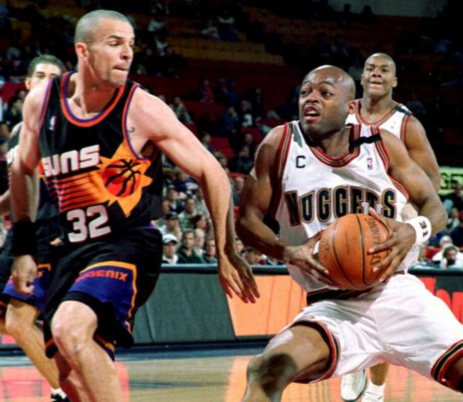 Poor Jason Kidd did not deserve the indignity of wearing that garish Suns jersey. (DAVID ZALUBOWSKI / Associated Press)