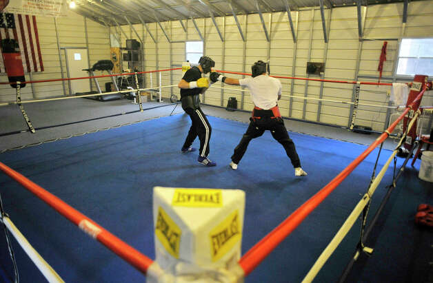 John Magda, left, spars with Delvin Rodriguez at their training camp in North Hudson, N.Y., on Tuesday, May 8, 2012. The Dominican-born and Danbury-raised Rodriguez will fight Austin Trout on June 2 for the World Boxing Association junior middleweight world championship. Photo: Jason Rearick / The News-Times