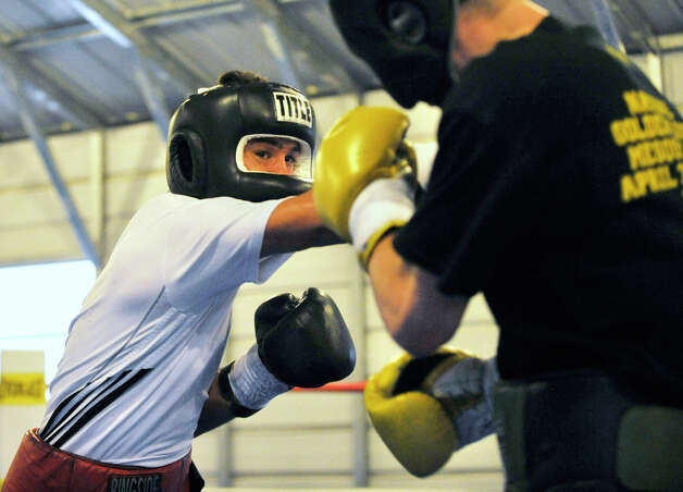 Delvin Rodriguez, left, spars with John Magda at their training camp in North Hudson, N.Y., on Tuesday, May 8, 2012. The Dominican-born and Danbury-raised Rodriguez will fight Austin Trout on June 2 for the World Boxing Association junior middleweight world championship. Photo: Jason Rearick / The News-Times