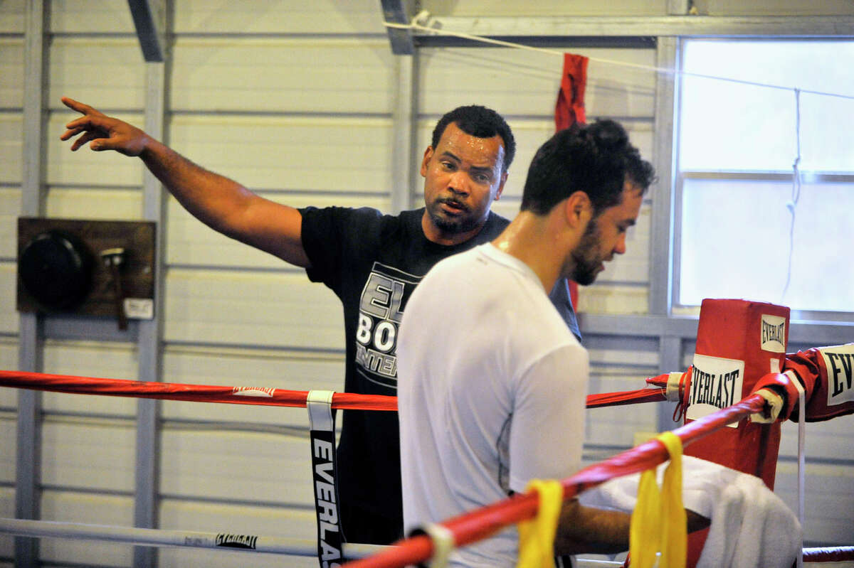 Trainer Fernely Feliz, left, talks with Delvin Rodriguez during a training break at their camp in North Hudson, N.Y., on Tuesday, May 8, 2012. The Dominican-born and Danbury-raised Rodriguez will fight Austin Trout on June 2 for the World Boxing Association junior middleweight world championship.
