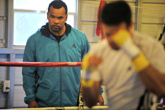 Trainer Fernely Feliz studies Delvin Rodriguez as Rodriguez works out in the ring of their training camp in North Hudson, N.Y., on Tuesday, May 8, 2012. The Dominican-born and Danbury-raised Rodriguez will fight Austin Trout on June 2 for the World Boxing Association junior middleweight world championship. Photo: Jason Rearick / The News-Times