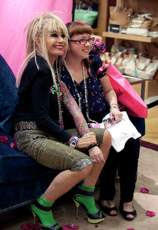 OTS/TRENDS/SALife HEIDBRINK  Designer Betsey Johnson poses with a fan during an appearance at Dillard's North Star. Photo by Jamie Karutz. Photo: Jamie Karutz / Special to the Express-News