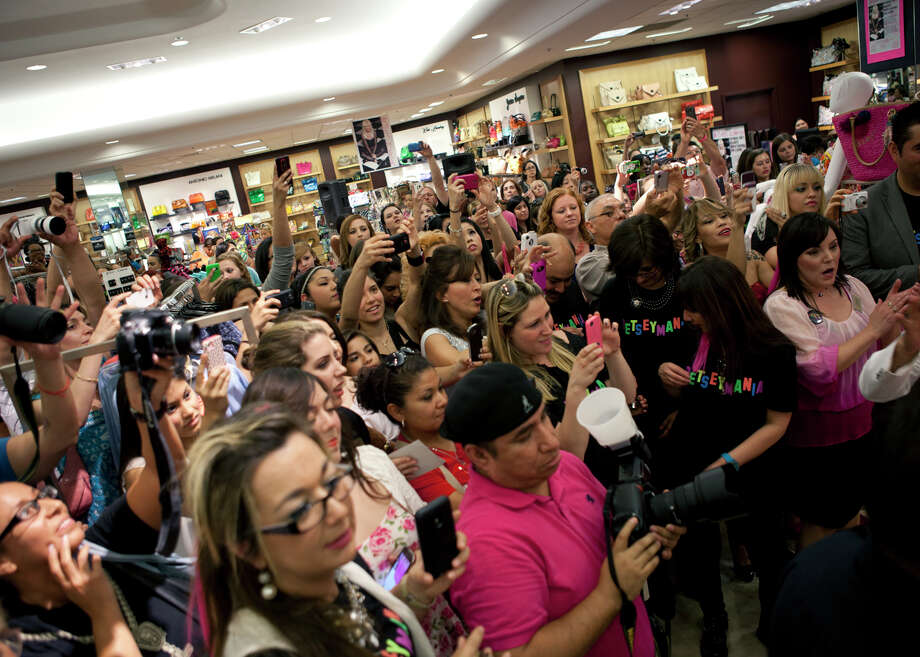 OTS/TRENDS/SALife HEIDBRINK  Fans jostle to take pictures of Betsey Johnson during an appearance by the designer at Dillard's North Star. Photo by Jamie Karutz. Photo: Jamie Karutz / Special to the Express-News