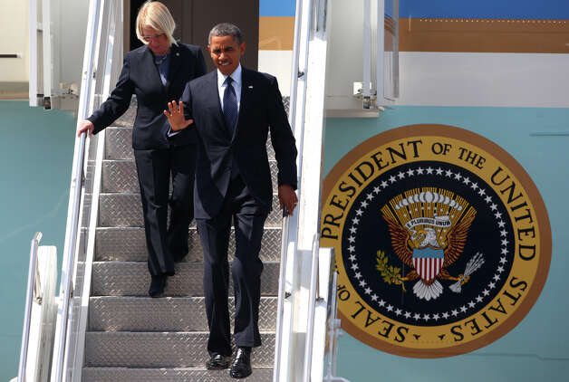 U.S. President Barack Obama leaves Air Force One with U.S. Senator Patty Murray at Boeing Field during a visit to Seattle on Thursday . The president was scheduled to attend two fund raisers during the visit. Photo: JOSHUA TRUJILLO / SEATTLEPI.COM