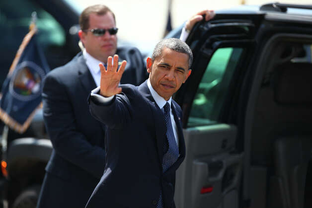 U.S. President Barack Obama waves to supporters after leaving Air Force One at Boeing Field during a visit to Seattle on Thursday . The president was scheduled to attend two fund raisers during the visit. Photo: JOSHUA TRUJILLO / SEATTLEPI.COM