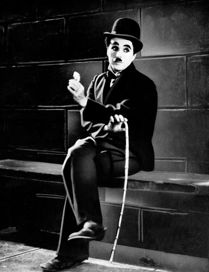 "FILE - In this 1931 film image originally released by United Artists, actor Charlie Chaplin is seen in the silent film ""City Lights.""  A new musical ""Chaplin,"" depicting the life of film icon Charlie Chaplin, will open on Broadway on Monday, Sept. 10, 2012 at the Barrymore Theatre in New York. (AP Photo, file) Photo: Anonymous"