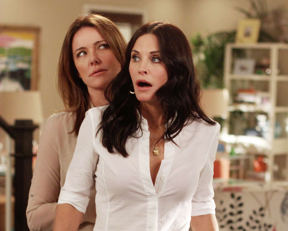 "In this publicity image released by ABC, Christa Miller, left and Courteney Cox are shown in a scene from the ABC comedy ""Cougar Town."" The ABC sitcom, a cult favorite but never a ratings blockbuster on broadcast television, will be moving to cable's TBS, the network said Thursday, May 10, 2012. TBS has ordered a fourth season of the sitcom, which was facing cancellation by ABC. New episodes are scheduled to begin airing early next year. (AP Photo/ABC, Michal Ansell) Photo: Michael Ansell"