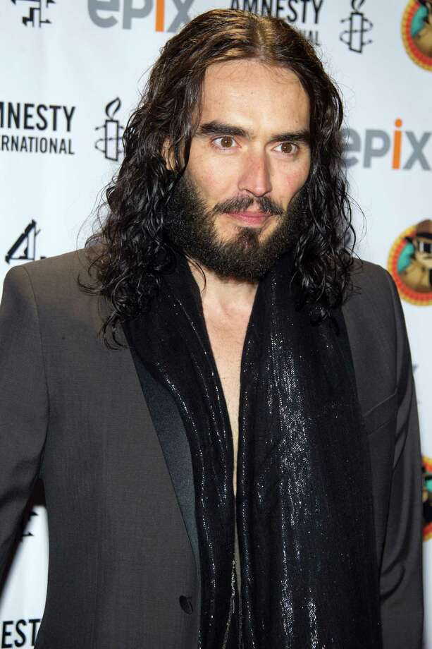 "FILE - In this March 4, 2012 file photo, Russell Brand arrives to Amnesty International's ""Secret Policeman's Ball"" in New York. MTV network says the 36-year-old comedian will host the 2012 MTV Movie Awards June 3, 2012. (AP Photo/Charles Sykes, file) Photo: Charles Sykes"