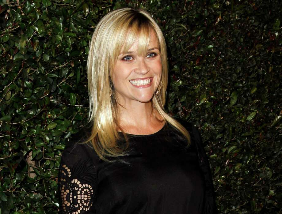 "FILE - In this April 13, 2012 file photo, actress Reese Witherspoon arrives at the world premiere of the music video for Paul McCartney's song, ""My Valentine.""  Witherspoon's mother has filed a petition of annulment to wipe out her husband's recent second marriage. Mary Elizabeth Witherspoon says in court documents filed May 8 in Nashville that her husband John Drake Witherspoon has taken a second wife who may be taking advantage of his mental condition. (AP Photo/Matt Sayles, file) Photo: Matt Sayles"