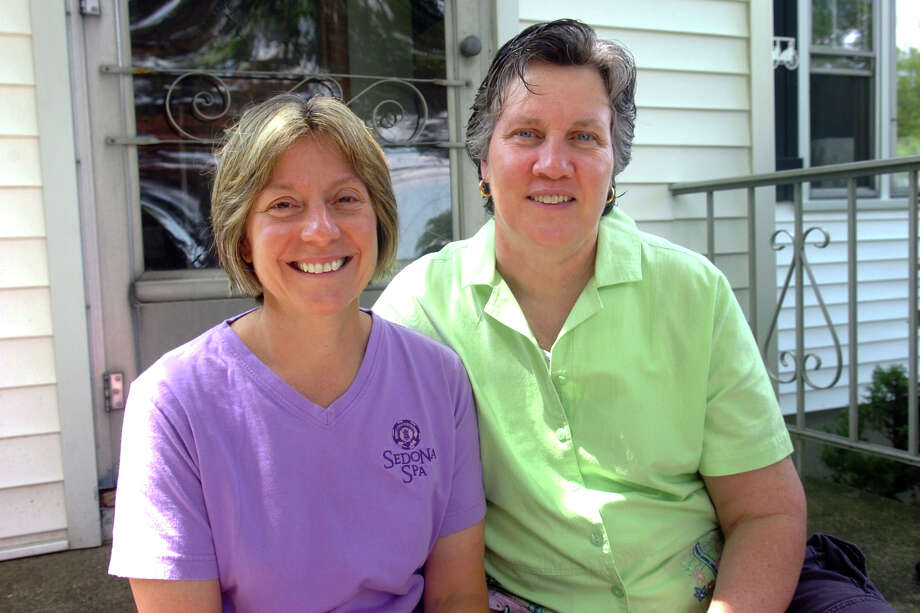 Judy Eckert and Liz McGovern on the front steps of their home in Bridgeport, Conn. June 30th, 2011. Photo: Ned Gerard, ST / Connecticut Post