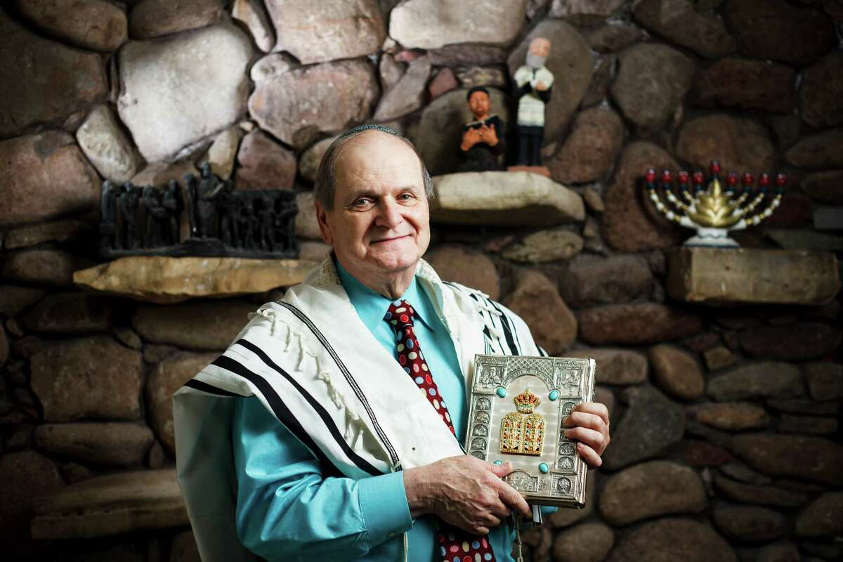 Max Mintz MD poses for a photo at his home, Wednesday, May 2, 2012, in Houston. Mintz is perhaps the busiest mohel (a Jewish person trained in the practice of brit milah