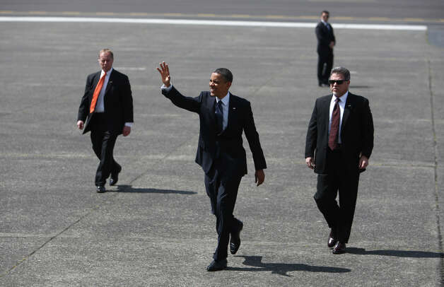 U.S. President Barack Obama walks away from Air Force One at Boeing Field during a visit to Seattle on Thursday. Photo: JOSHUA TRUJILLO / SEATTLEPI.COM
