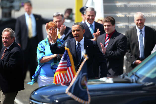 U.S. President Barack Obama waves to supporters as he exits Air Force One at Boeing Field during a visit to Seattle on Thursday. Photo: JOSHUA TRUJILLO / SEATTLEPI.COM