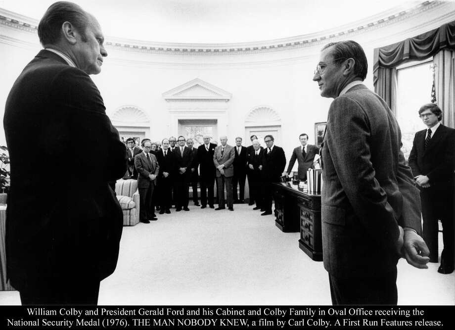 William Colby and President Gerald Ford and his Cabinet and Colby Family in Oval Office receiving the National Security Medal (1976). THE MAN NOBODY KNEW, a film by Carl Colby. A First Run Features release. Photo: First Run Features