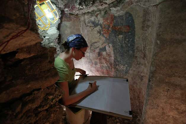 "Skidmore College's Heather Hurst sketches paintings at an excavation site where archeologist William Saturno uncovered Maya murals in mounds that are thought to be residences dating from around 800 AD. The site is called ""Xultun"" and is located near Tikal in the province of Peten in northeastern Guatemala. (Photo by Tyrone Turner © 2012 National Geographic) Photo: Tyrone Turner / Tyrone Turner Photographer"