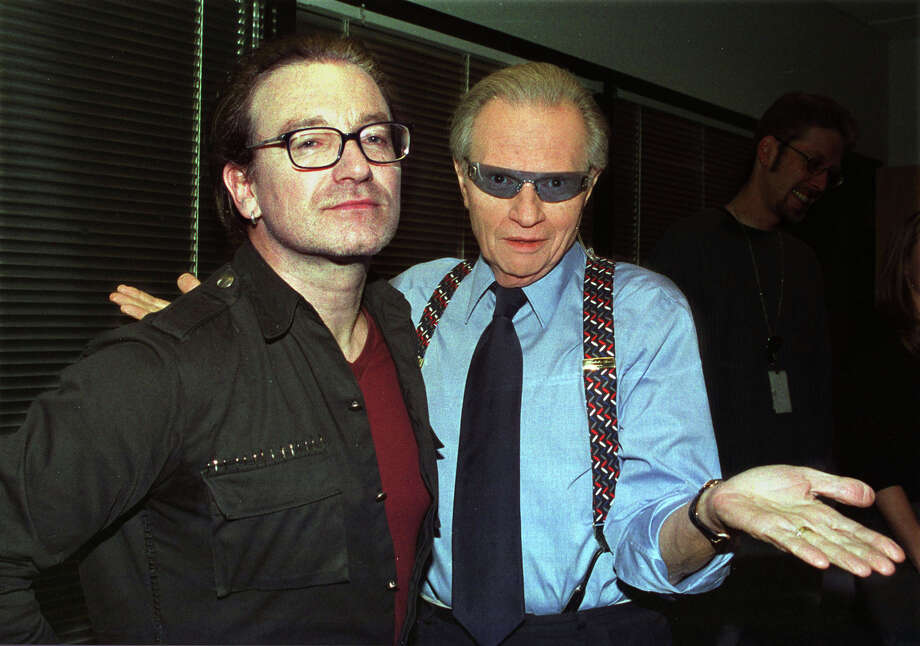 """Irish singer Bono, left, of the group """"U2"""" trades eyeglasses with CNN talk show host Larry King as they pose Nov. 19, 2002 at the CNN studios in Los Angeles in this photograph released Monday, Nov. 25, 2002. Photo: ROSE M PROUSER, AP / CNN"""
