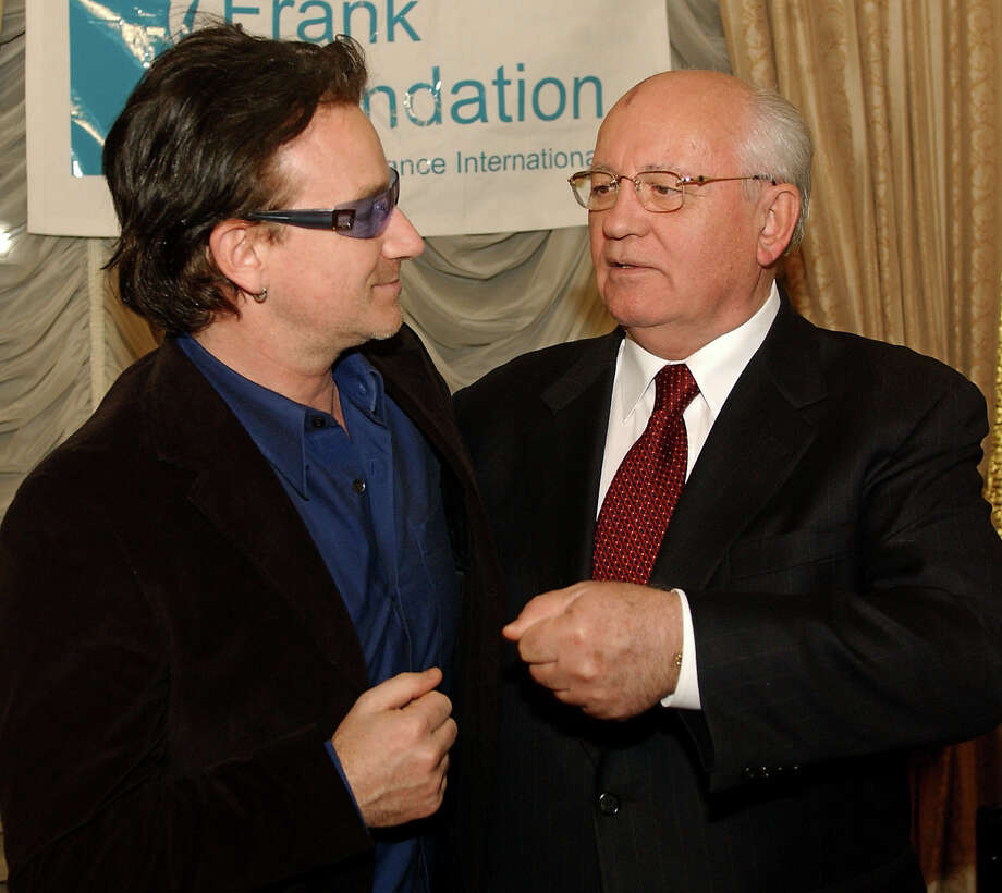 Former President of the Russian Federation Mikhail Gorbachev, right, and Bono, left, of the rock group U2, speak before a dinner hosted by Mr. Gorbachev, Sunday, March 10, 2002, at the Russian Embassy in New York in honor of the Frank Foundation Child Assistance International of Washington D.C. Photo: STEPHEN CHERNIN, AP / AP
