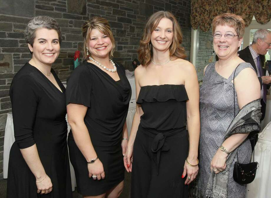 "Voorheesville, NY - May 4, 2012 - (Photo by Joe Putrock/Special to the Times Union) - (l to r) Christina Dutch, Denise Rafferty, Jill Parsons and Kate Barnhart, all of event sponsor PricewaterhouseCoopers, LLP, during the ""Reach for the Stars"" Gala, to benefit Equinox. Photo: Joe Putrock / Joe Putrock"