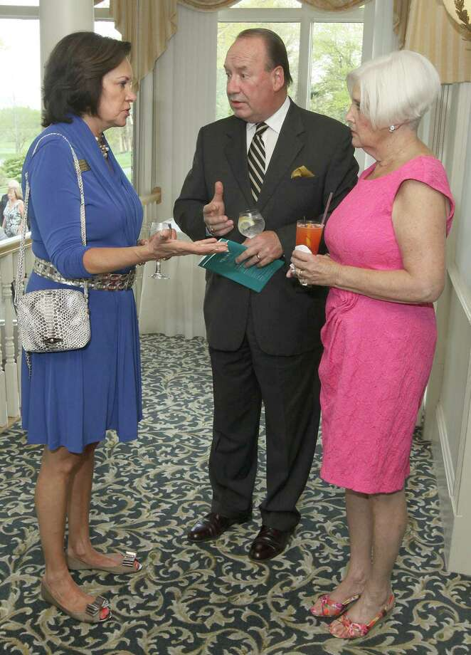 """Voorheesville, NY - May 4, 2012 - (Photo by Joe Putrock/Special to the Times Union) - Equinox Senior Development Officer Deborah Scott Molyneux(left) talks with NBT Bank Wealth Management Advisor Robert Dollard(center) and his wife Gail(right) during the """"Reach for the Stars"""" Gala, to benefit Equinox. Photo: Joe Putrock / Joe Putrock"""