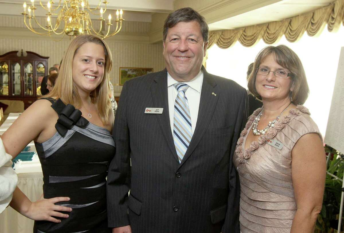 Voorheesville, NY - May 4, 2012 - (Photo by Joe Putrock/Special to the Times Union) - President of Capital Region District, Keybank National Association Jeff Stone(center) poses with his wife Diane(right) and his daughter Brianna(left) during the