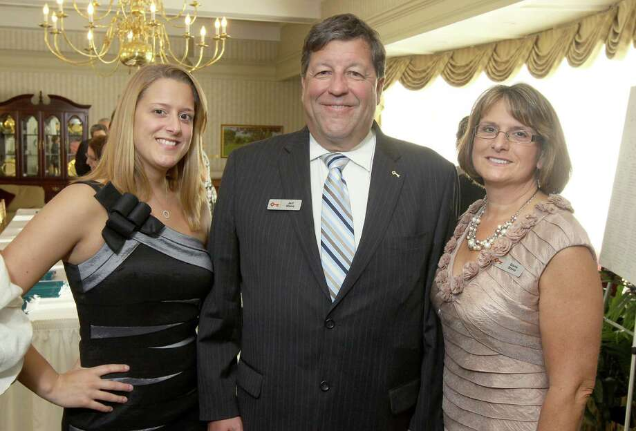"Voorheesville, NY - May 4, 2012 - (Photo by Joe Putrock/Special to the Times Union) - President of Capital Region District, Keybank National Association Jeff Stone(center) poses with his wife Diane(right) and his daughter Brianna(left) during the ""Reach for the Stars"" Gala, to benefit Equinox. Jeff and Diane Stone were Event CommitteeCo-Chairs. Photo: Joe Putrock / Joe Putrock"