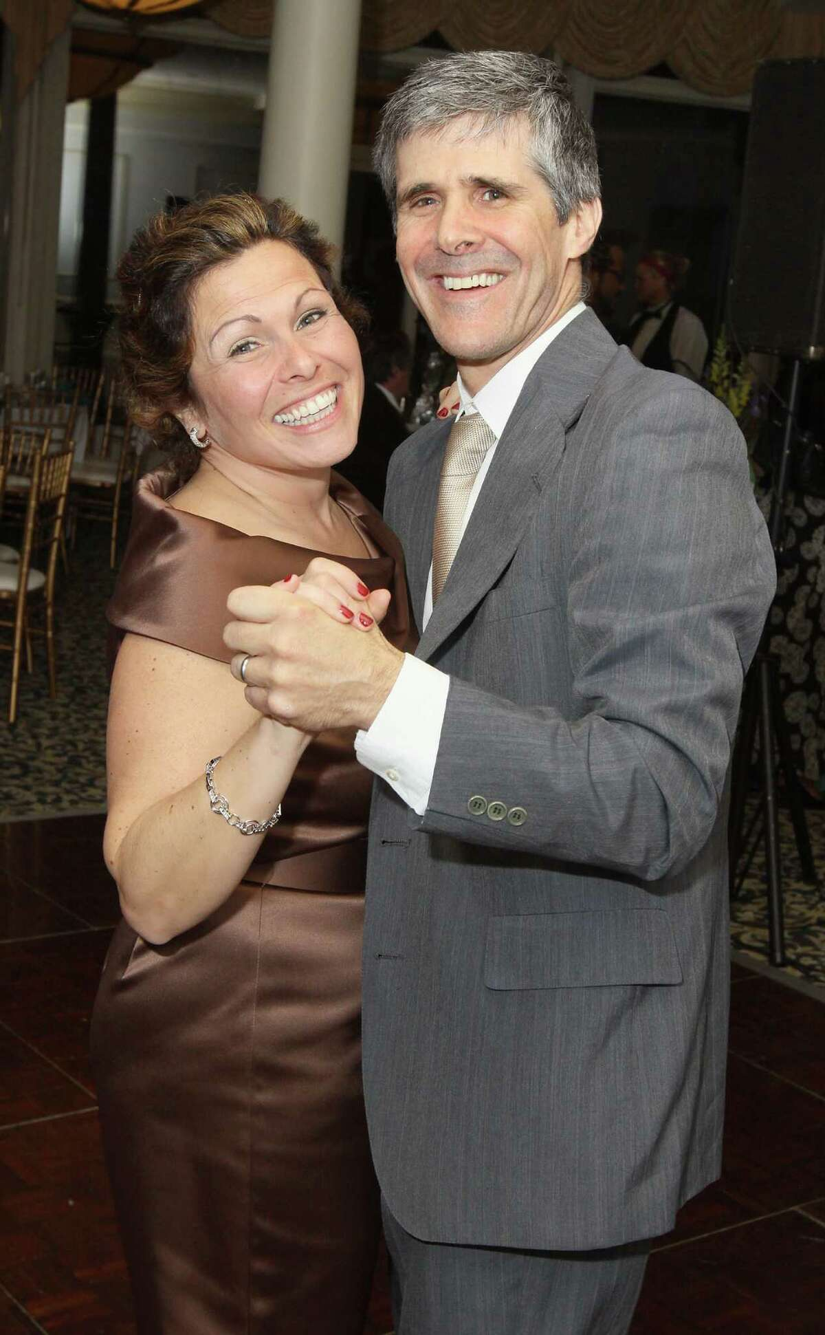 Voorheesville, NY - May 4, 2012 - (Photo by Joe Putrock/Special to the Times Union) - Ann MArie Lizzi(left) and her husband John Rizzo(right) hit the dancefloor during the