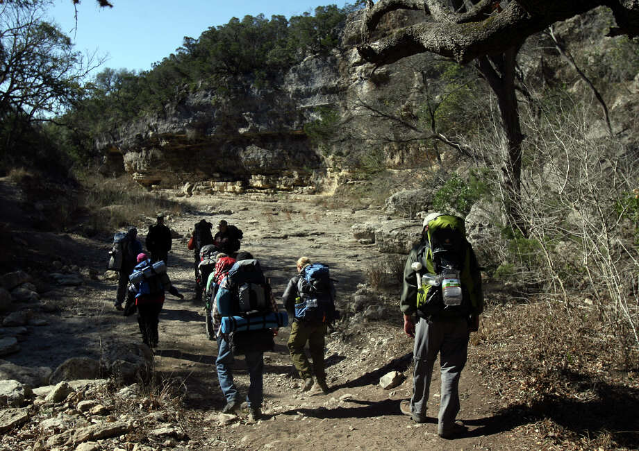 Hikers walk through Government Canyon State Natural Area Sunday. Trainers with a group called Leave No Trace was teaching people how to minimize their impact on public recreational areas.  Photo: JOHN DAVENPORT, SAN ANTONIO EXPRESS-NEWS / jdavenport@express-news.net