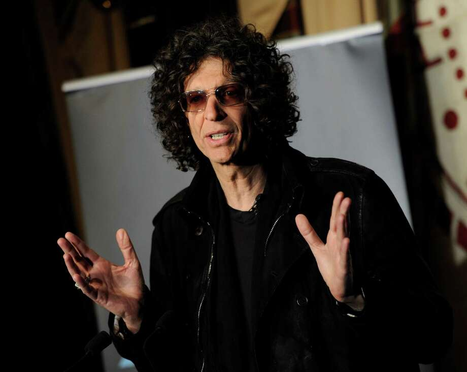 "SiriusXM satellite radio talk show host Howard Stern speaks to the media about his new role as a judge on ""America's Got Talent"" at the Friars Club on Thursday, May 10, 2012 in New York. Photo: AP"