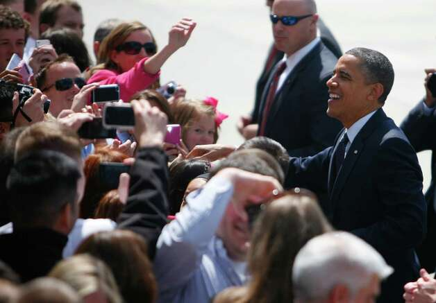 U.S. President Barack Obama greets a group of supporters at Boeing field on Thursday. Photo: SOFIA JARAMILLO / SEATTLEPI.COM