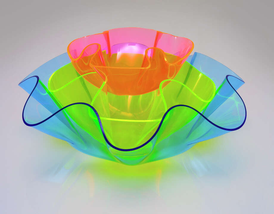 In this undated handout photo released by Art Innovation Style, wavy acrylic bowls in an array of neon hues are seen. (AP Photo/Art Innovation Style)