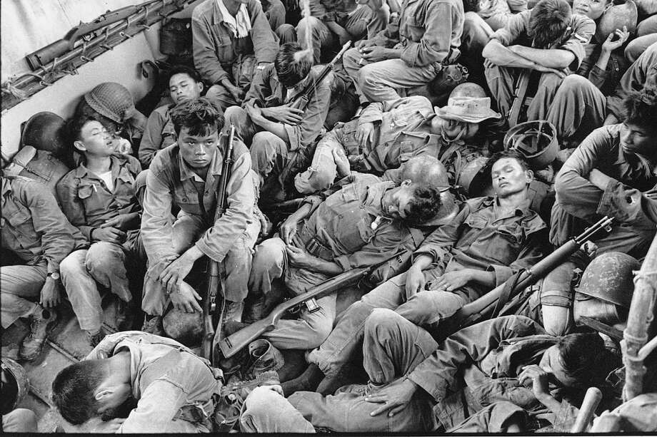 In this Aug. 1962 file photo shot by Associated Press photographer Horst Faas, South Vietnamese government troops from the 2nd Battalion of the 36th Infantry sleep in a U.S. Navy troop carrier on their way back to the Provincial capital of Ca Mau, Vietnam. Faas, a prize-winning combat photographer who carved out new standards for covering war with a camera and became one of the world's legendary photojournalists in nearly half a century with The Associated Press, died Thursday May 10, 2012. He was 79. (AP Photo/Horst Faas, File) Photo: HORST FAAS, Associated Press / AP1962