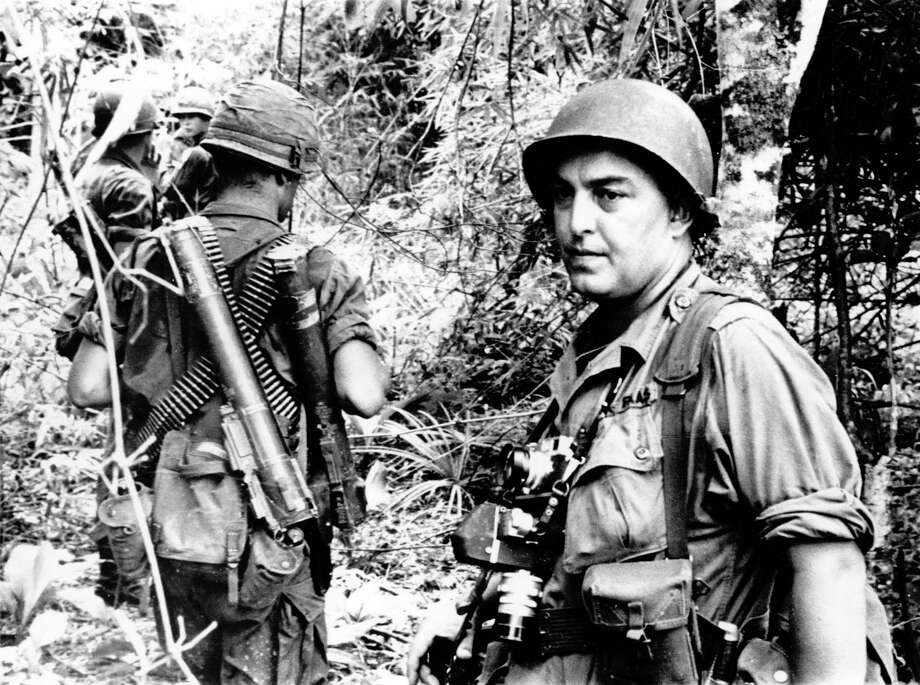 In this undated file photo, Associated Press photographer Horst Faas is shown on assignment with soldiers in South Vietnam. Faas, a prize-winning combat photographer who carved out new standards for covering war with a camera and became one of the world's legendary photojournalists in nearly half a century with The Associated Press, died Thursday, May 10, 2012. He was 79. (AP Photo/File) Photo: Associated Press / AP