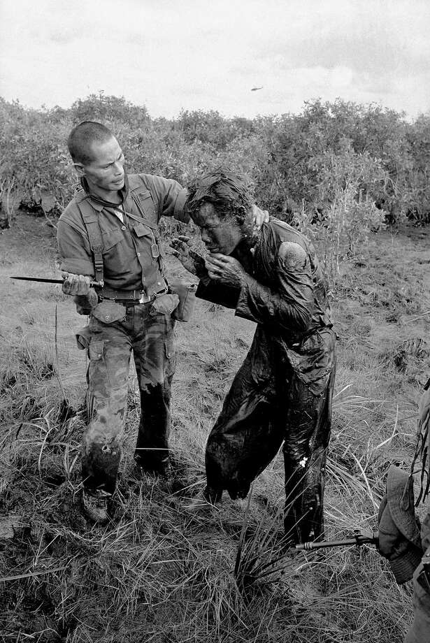 In this Jan. 9, 1964 file photo one of several shot by Associated Press photographer Horst Faas, earning him the first of two Pulitzer Prizes, a South Vietnamese soldier uses the end of a dagger to beat a farmer for allegedly supplying government troops with inaccurate information about the movement of Viet Cong guerrillas in a village west of Saigon, Vietnam. Faas, a prize-winning combat photographer who carved out new standards for covering war with a camera and became one of the world's legendary photojournalists in nearly half a century with The Associated Press, has died May 10, 2012. He was 79.  (AP Photo/Horst Faas, File) Photo: Horst Faas, Associated Press / AP