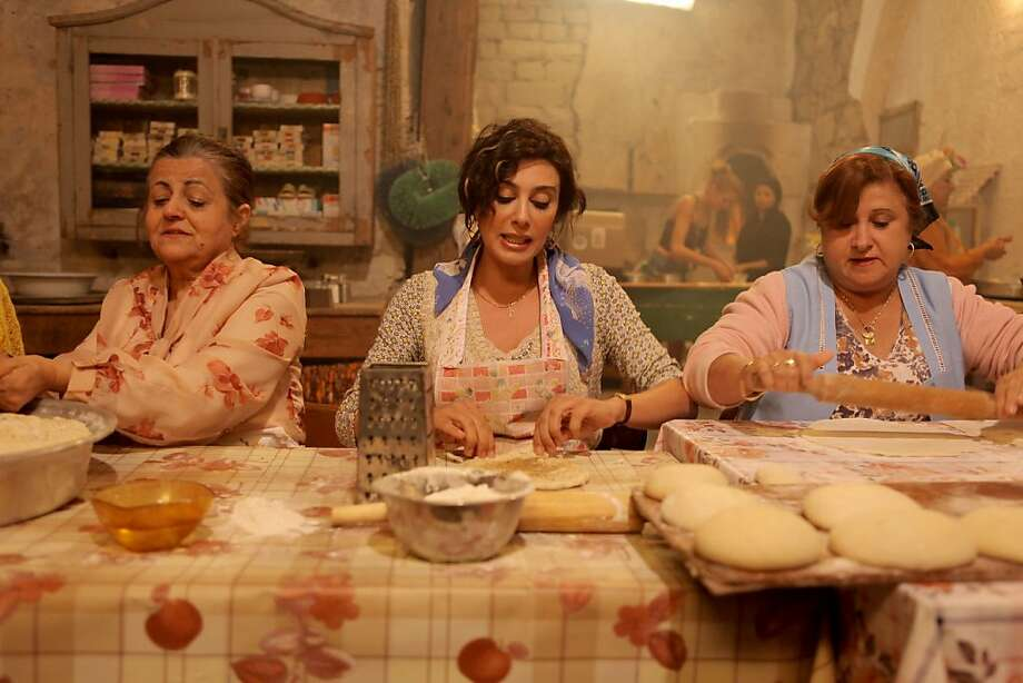 "Nadine Labaki (center) in ""Where Do We Go Now?"" Photo: Pathe, Outnow.ch"