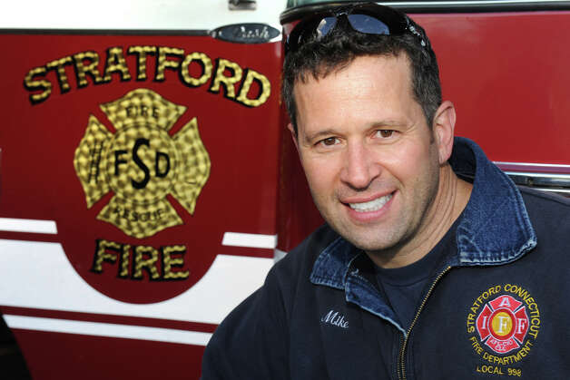 Mike Apatow, of Milford, poses at Stratford Fire Station, Company 2, in Stratford, Conn. May 10th, 2012, where he works as firefighter. Apatow, who had a radioactive stress test Wednesday, was pulled over later in the day, in Newtown, by a state police trooper after a radioactivity detector in the trooper's car was set off when Apatow passed. The detectors are used to help identify potential terror threats. Apatow was not on duty at the time. Photo: Ned Gerard