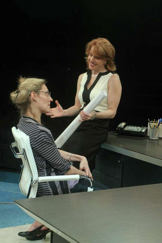 "(For the Chronicle/Gary Fountain, May 8, 2012)  Julia Motyka as Eliza, left, and Nancy Lemenager as Janice, in this scene from the Alley Theatre's production of Theresa Rebeck's new play ""What We're Up Against."" Photo: Gary Fountain / Copyright 2012 Gary Fountain."