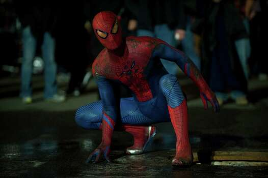 """Andrew Garfield stars as Spider-Man/Peter Parker in Columbia Pictures' """"The Amazing Spider-Man,"""" also starring Emma Stone. Photo: Jaimie Trueblood / © 2012 Columbia Pictures Industries, Inc.  All Rights Reserved. **ALL IMAGES ARE PROPERTY OF SONY PICTURES ENTERTAINMENT INC. F"""