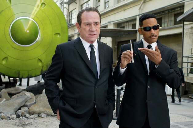 "Agent K (Tommy Lee Jones, left) and Agent J (Will Smith) are back on the case in ""MIB3."" Photo: Saeed Adyani / © 2011 Columbia Pictures Industries, Inc.  All rights reserved."