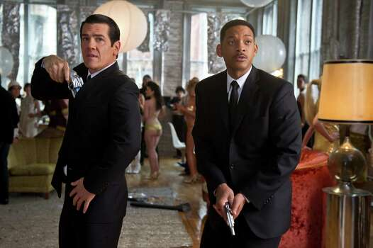 """Tommy Lee Jones, left, and Will Smith reprise their roles as intergalactic secret agents in """"Men in Black 3."""" Photo: Wilson Webb / © 2011 Columbia Pictures Industries, Inc.  All rights reserved."""
