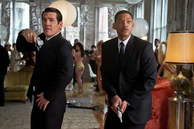 "Tommy Lee Jones, left, and Will Smith reprise their roles as intergalactic secret agents in ""Men in Black 3."" Photo: Wilson Webb / © 2011 Columbia Pictures Industries, Inc.  All rights reserved."